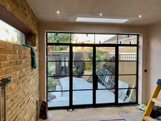 Steel Look french doors with fixed side and top panels almost finished, all horizontal bars are thick to match with steel all our finishes are powder coated and are bespoke Tilt And Turn Windows, Windows And Doors, Crittal Doors, Crittall, New York Loft, Aluminium Windows, Folding Doors, Back Doors, Home Renovation