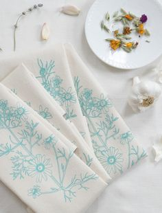 """Cloth Dinner Napkins - Set of 4 - Chamomile Print - Handmade - Hand-printed - Unpaper Towels - Cotton Napkins - Washable - Reusable. A set of four natural cotton napkins, hand-printed with my original Chamomile design in mint green. Each napkin is approximately 20"""" x 20"""" and is reusable and washable. These soft and absorbent flour sack cotton napkins are printed in small batches using eco friendly ink. As a botanical illustrator and avid naturalist and gardener, I have a love of bringing…"""