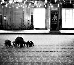 Man and Boys Praying at Mosque