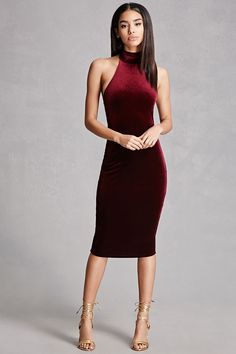 A knit velvet dress featuring a mock halter neck with self-tie straps and a bodycon silhouette.