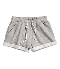 Short shorts in melange sweatshirt fabric with elasticized drawstring waistband. Sewn cuffs at hems.