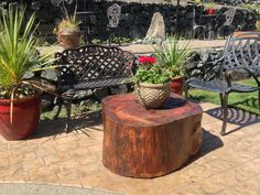 Large piece of firewood turned into a patio table