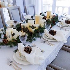 This lovely holiday table from the @fashionablehostess is the perfect setting that can straddle both Thanksgiving and Christmas. We love the simple centerpiece that uses our pillar candles and holiday garland. #entertaining #mypotterybarn #holidays #tabletop #christmasparties