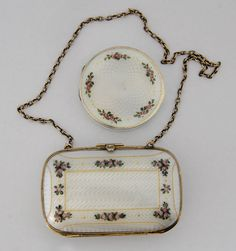 Gustav Gaudernack design for David Andersen. Small gilt guilloché silver wallet and a powder compact with translucent enamel and rose motif enamel painting. Photo A.M Vindedal