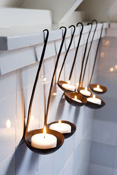 ladles as tea light candle holders!  Such a cool idea!  You could hang these on a rope outside over a dining table - or under a large umbrella...I can think of so many places.