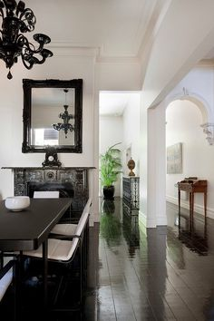 gorgeous...love the black glossy floors with the beautiful white architecture..