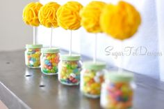 Baby food jar used as a base for a topiary. Cute table decoration/favor for a shower. From Sugar Tot Designs