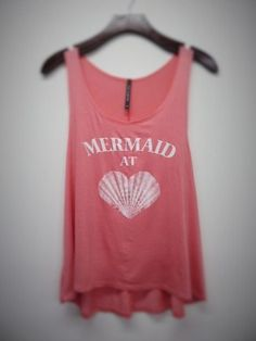 A personal favorite from my Etsy shop https://www.etsy.com/listing/401015353/mermaid-at-heart-tank-top-coral