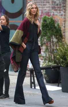 Model street style | Flared pants and color block poncho