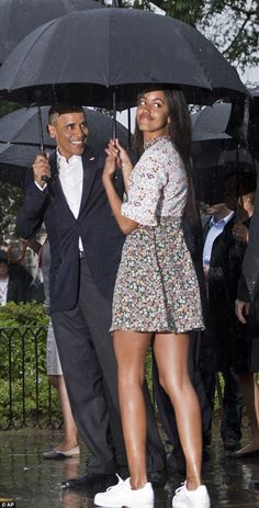 Getting comfy: Later, Malia switched her strappy black flats for white sneakers, which looked adorable with her mixed-print frock