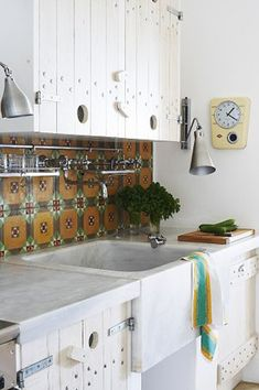 Love the holes in the cabinets for knob openings.   desire to inspire - desiretoinspire.net - Mark Williams