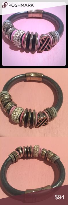 NWOT! Charmed bracelet Bracelet charmed with silver hoops, gems, and breast cancer awareness charm. Grey, pink, silver & white. Has a hefty silver magnetic closure. Bracelet is bendy and comfortable. Very well made, thick & durable. Never worn! Jewelry Bracelets