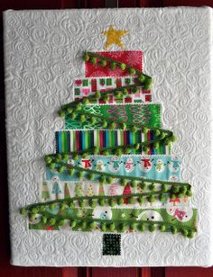 adorable quilted 'tree' -- there's even a link to the tute!