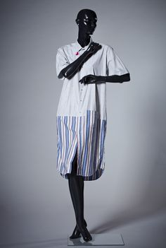 Shirt-dress created by Ghitta Laskrouiff. Mixutre of white, black, blue and red stripes  Displayed at the exhibition Fashion Cities Africa, Brighton Museum & Art Gallery April 2016-January 2017.  Professional images of outfits, clothes and accessories, mostly arranged in their original 'looks' from Fashion Cities Africa exhibition, 2016-2017, taken by Tessa Hallmann on our behalf