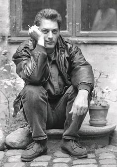 Paul Benjamin Auster (b. February 3, 1947), is an American author and director whose writing blends absurdism, existentialism, crime fiction, and the search for identity and personal meaning in works such as The New York Trilogy (1987), Moon Palace (1989), The Music of Chance (1990), The Book of Illusions (2002), and The Brooklyn Follies (2005).