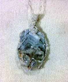 Agate druzy stone wire wrapped with sterling wire in a random pattern to match the unique stone.