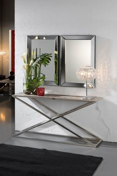 Striking in any setting, the Designer wood and polished steel console table. The console top is produced with an antique style solid wood finished with a white patina mounted on a polished steel frame. Divine!