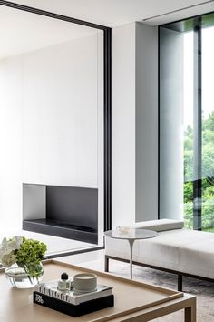 A modern minimalist living room with floor-to-ceiling windows and a neutral colour palette. #livingroom #modernhome #moderndesign #livingarea #loungeroom #coffeetable Modern Minimalist Living Room, Interior Architecture, Interior Design, World Of Interiors, Floor To Ceiling Windows, Coastal Homes, Lounge Areas, Living Room Inspiration, Furniture Design