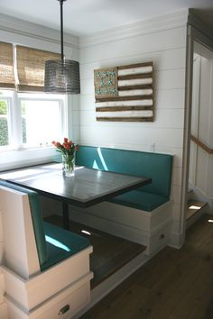 fun kitchen banquette with flag art