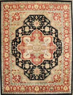 This fabulous hand-knotted rug from India is made with the finest 100% hand spun wool available. The traditional Serapi design mimics the old masters but has an updated look and utilizes today's trendy colors. The rust and mossy green tones are...