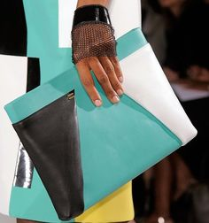 We loved @Roland Mouret's colour-blocked clutch bags; what...