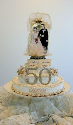How Shabby Chic vintage awesome! A paper cake! Looks lovely and made by the Red Shed!