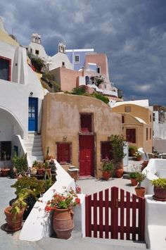Houses in Oia village Santorini Mykonos, Oia Santorini Greece, Santorini Island, Paros Greece, Places Around The World, Oh The Places You'll Go, Places To Travel, Places To Visit, Around The Worlds