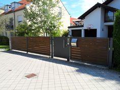 Einfahrtstor in grau mit braunen Tor