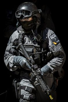 Military Armament with police dressed like this, protect and serve who,and what ???