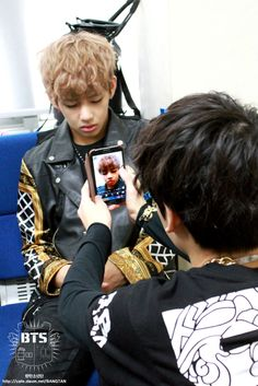 sleeping Taehyung and Jungkook taking a picture of him