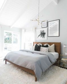 everything about this room is perfect! the artwork, the headboard, the pillows and comforter, the lighting, the white rug