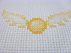 FIBERARTSY/craftsy: Stitching the sadness away.....Harry Potter cross stitch, Golden Snitch