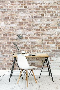 Love the clean and minimal look of Scandi interiors? This white paint brick wallpaper marries stripped back elegance with industrial design. It's ideal for contemporary living room spaces, or inspiring desk spaces. The only thing missing is a faux sheepskin fur draped over the chair!: