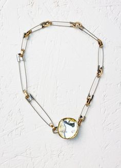 Fall / Winter Runway 2016 - Pebbles Necklace in Resin and Brass | セリーヌについて