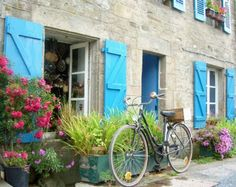 Cotentin-house-in-normandy- Want to visit. Love the Teal Shutters