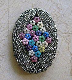 Vintage Cut Steel Beaded Flower Pin  via keepsakejewels