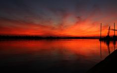 """""""Fire on the River"""" by Judy Vincent, taken in Port Neches, Texas, United States of America. Available for purchase at http://judy-vincent.artistwebsites.com/"""