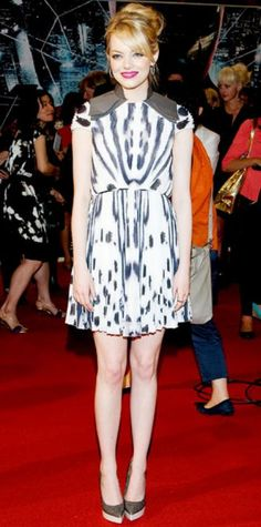 Look of the Day › June 17, 2012 WHAT SHE WORE Emma Stone walked the red carpet at the Seoul premiere of The Amazing Spider-Man in a pleated Fendi cocktail dress, diamond Cartier jewels and platform pumps. WHY WE LOVE IT The actress brought the drama onscreen and off in her graphic, strong-shouldered design.