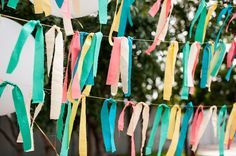 I think this type of garland around the boys' room would be perfect in tougher fabric of course--maybe stripes and whatever colors we land on for the room.