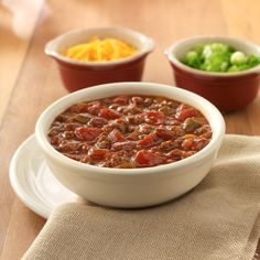 30-Minute Chili Chunky chili made quickly with ground meat, beans and two kinds of tomatoes for lots of flavor —- perfect for a weekni...