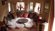 http://www.offgridquest.com/homes-dwellings/home-stylings/15-natural-built-interiors