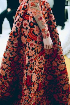 valentino.  I know that this dress would wear me, but i don't think I really care about that....