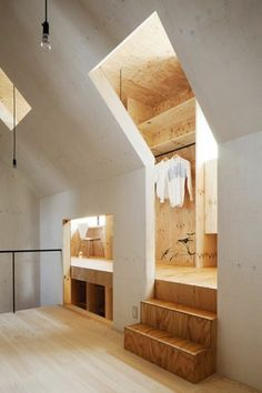 Larch plywood clads personal spaces which wrap around a central living area in a Japanese home by MA-style Architects. - Architecture and Home Decor - Bedroom - Bathroom - Kitchen And Living Room Interior Design Decorating Ideas - Design Exterior, Interior And Exterior, Interior Doors, Retail Interior, Interior Paint, Interior Cladding, Interior Office, Interior Livingroom, Room Interior