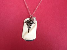 SIlver Dog Tag with Nurse Symbol and Birth by treasuredheros1, $43.00 Love this Nurses necklace...