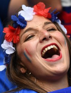 #EURO2016 A France supporter cheers prior to the Euro 2016 round of 16 football match between France and Republic of Ireland at the Parc Olympique Lyonnais...