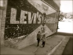 rustic levi's advertising painting on old building