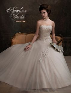 Lovely strapless, shimmering tulle and reembroidered lace ball gown with chapel train