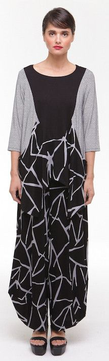 Flattering and beautifully shaped top over full pants in abstract print.