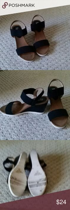 ADORABLE black and white wedges. Strap around the Ankle is elastic so they're very comfortable! refresh Shoes Wedges