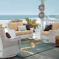 The outdoor rug picks up the azure shades of the sea.  Gliding Stewart Collection tropical patio